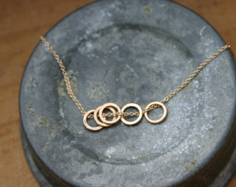 5 gold circle necklace.