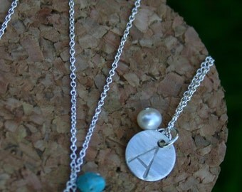 silver initial necklaces.