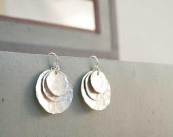 triple disc earrings.