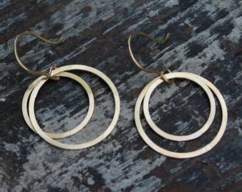 medium double open circle earrings.