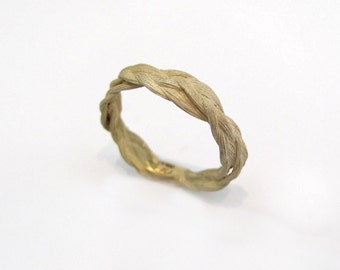 Zopf braided ring twisted in 18kt gold
