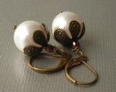 pearl earrings, floral bead cap