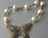 butterfly and pearl linked necklace