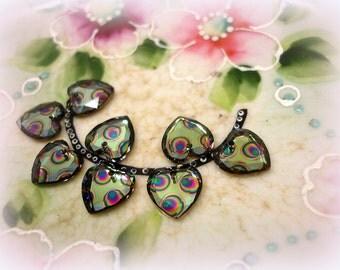 unUsual swarovski peacock eye heart pendants .  5 piece 10mm rhinestone hearts with colorful peacock eyes . peridot multi