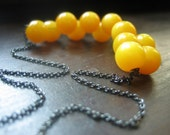 Mustard Seed Necklace with Vintage Lucite Yellow Button Beads and Gray Gunmetal Chain