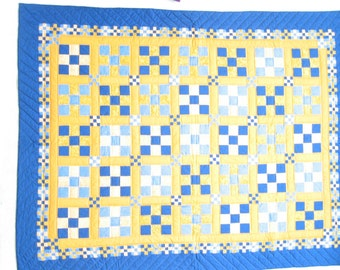 handquilted nine patch bed quilt