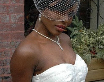 Fly away birdcage veil with vintage style brooch fascinator
