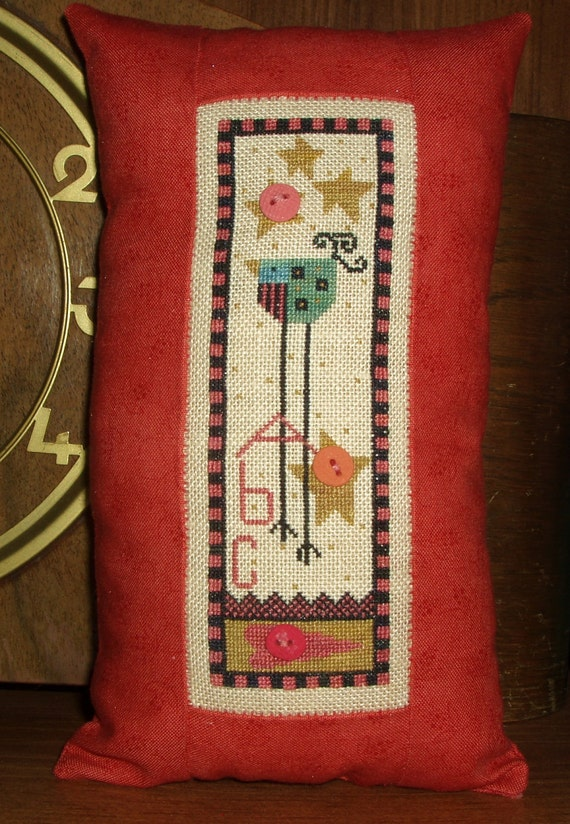 Completed Cross Stitch Ewe and Eye and Friends Pillow