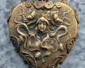 An absolutely gorgeous true Art Nouveau Nature goddess brass pendant wrapped in a flurry of filigree..