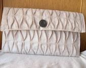 Textured beige envelope clutch purse with wooden button closure