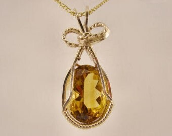 LCC Oval Shaped 28 ct. Citrine Pendant, Yellow Gold
