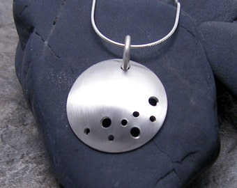 Circle Necklace with a Brushed Satin Finish, Moon and Stars Design