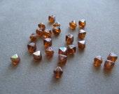 6mm Dark Topaz AB Czech Glass Bicone Beads