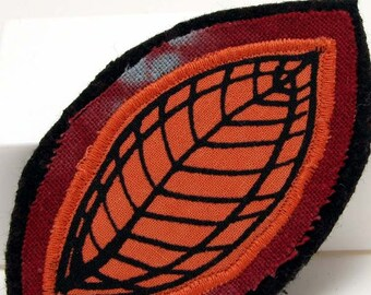 Fiber art brooch pin, fabric brooch, textile art jewelry, leaf motif brooch, screenprinted, autumn leaf, coat jacket art pin, pumpkin orange
