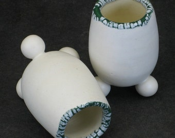 set of two white and dark green shot glasses