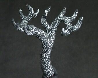 white and black jewelry tree
