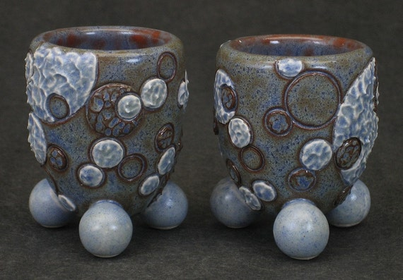 set of two blue and brown shot glasses with textured molecular motif