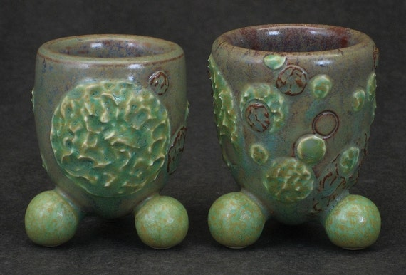 set of two green, beige, and brown shot glasses with textured molecular motif