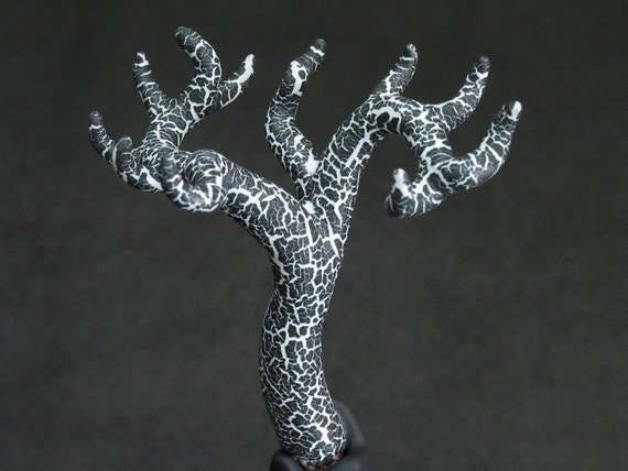 white and black jewelry tree
