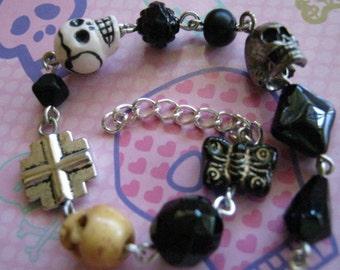 Black Skulls and Black Beads Charm Bracelet