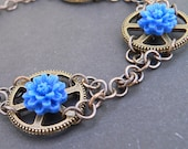 Steampunk Bracelet - Azure Blue flowers set on brass effect cogs linked by handmade chain
