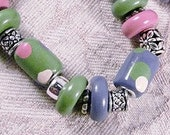 Bracelet Stretch Polymer Clay Beads in Green and Purple Dots