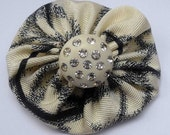Vintage fabric yoyo brooch in black and off-white with fancy pants rhinestone button