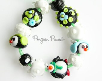 Penguin Parade winter glass beads handmade lampwork glass beads by Marianna Star Girl Jewelry