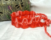 red and pink hand knotted wide friendship bracelet