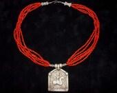 Multi strand sponge-coral with warrior talisman