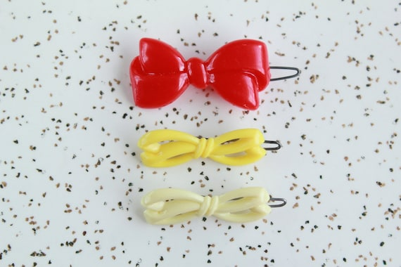 Red & yellow bows - vintage barrettes