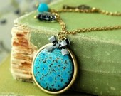 I dream in Turquoise . brass charm necklace