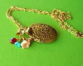 Memory Necklace, gold plated chain with locket and flowers necklace.