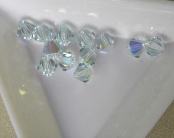 12pc Genuine Swarovski Bicone Beads 5301 6mm Light Azore AB