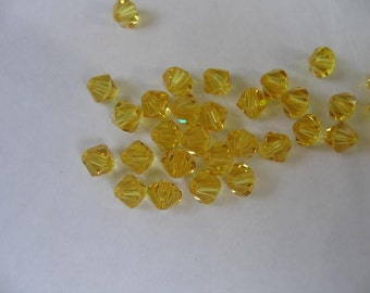24pc Genuine Swarovski Bicone Beads 5301 3mm Light Topaz