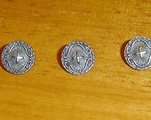 3 ornate, metal buttons