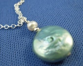 Seafoam green coin pearl, white freshwater pearl, and sterling silver pendant necklace