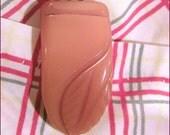 1940s orange leaf carved bakelite dress clip