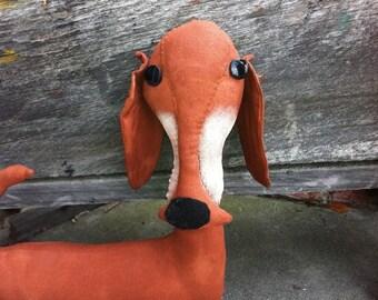 Primitive Reddish Brown Weiner Dog