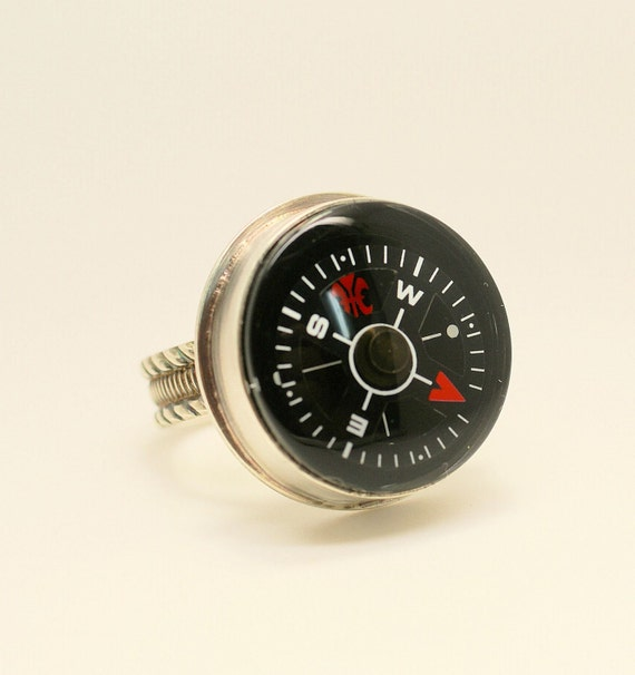 Lost or found your way made from Argentium silver and liquid compass