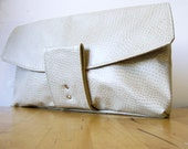 the broome street clutch in cream fleather