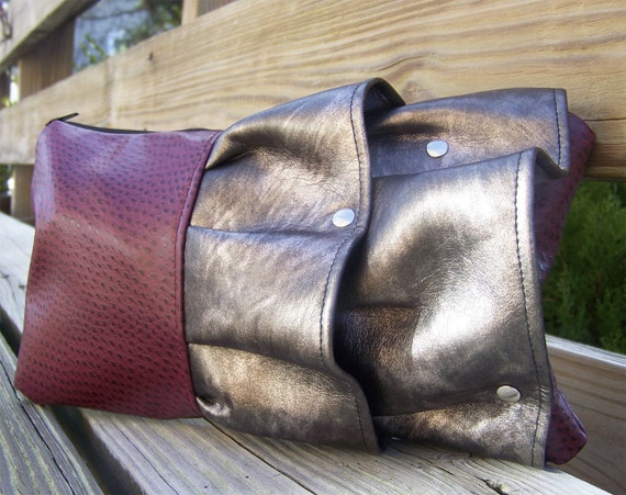 ruffled clutch in cranberry and pewter fleather