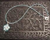 pale blue sakura blossom necklace