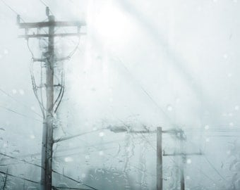 What It Feels Like : Photographic Print of a city moment, wires and telephone poles stand resolute amidst an aqua sky, washed with rain