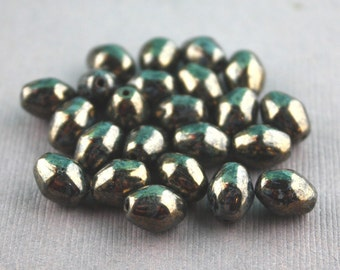 Vintage Black Metallic Glass Oval Bicones 7mm x 8mm