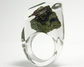 Clear resin ring with bornite