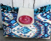 Beautiful Shades of Blue Ikat print Clutch with White Vinyl Detail and Red Clay Button