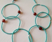Seed Bead Necklace. Blue Turquoise Seed Bead and Orange Carnelian Circles.