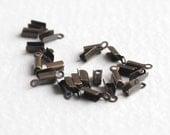 Antiqued Brass Fold Over Crimps (24X) (F545)