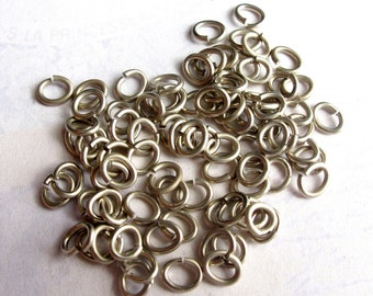 Rhodium Plated Oval Jump Rings 6mm x 5mm -  30 grams (approx 320x) (F553)